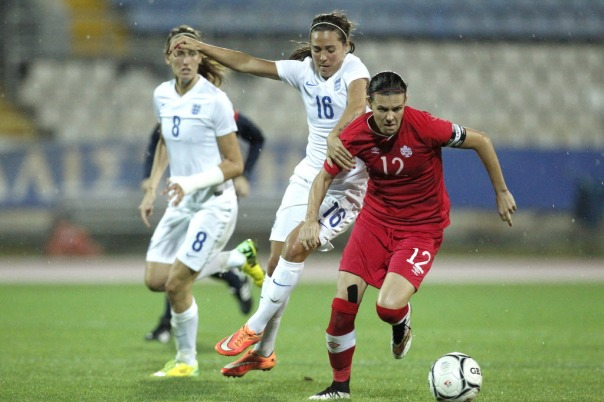 Christine Sinclair, right, of Canada challenges for the ball with Fara Williams of England during the Cyprus Women's Cup soccer final match, at GSP stadium in Nicosia, Wednesday, March 11, 2015. (AP Photo/Petros Karadjias)